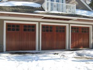 Three wood single residential garage doors | Saco, ME
