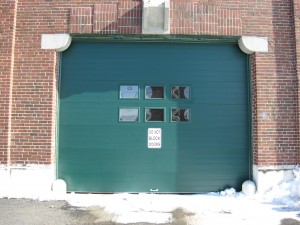 Green commercial garage door | Wiscasset, ME